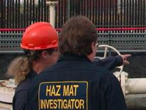 Image of two people at a hazmat incident